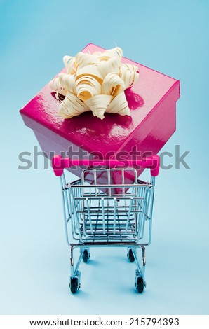Shopping cart with large gift - stock photo