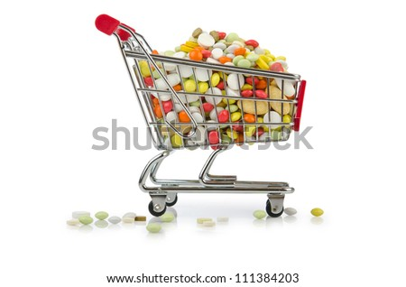 Shopping cart with many colourful pills - stock photo