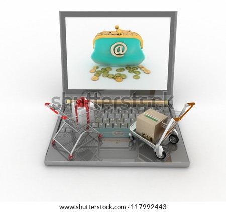 Shopping carts and laptop. The concept of buying gifts and commodities on the Internet - stock photo