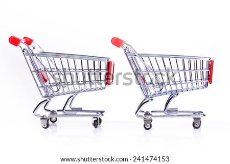 shopping carts isolated on white - stock photo
