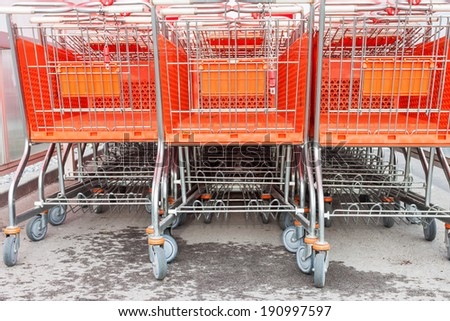 Shopping carts on a parking lot . Detail of a shopping cart - stock photo