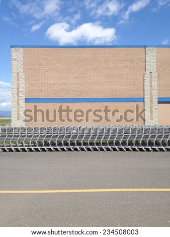 Shopping carts stored outside a store - stock photo