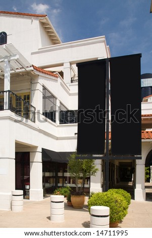 Shopping center with black blank sign-age for customization - stock photo