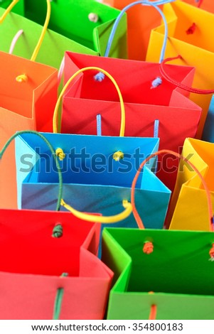 Shopping colorful sale paper bags close-up as background - stock photo