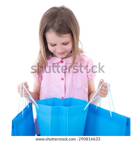 shopping concept - cute little girl with bags isolated on white background - stock photo