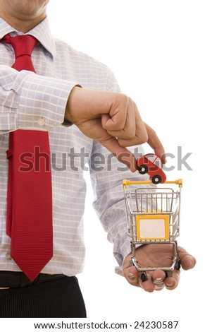 Shopping concept - Hand putting a car on a trolley shop - stock photo