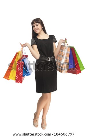 Shopping Concept: Happy Smiling Caucasian Woman with Shopping Bags. Isolated Over White Background. Vertical Image - stock photo