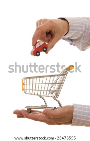 Shopping concept - Man putting a car on a trolley shopping - stock photo