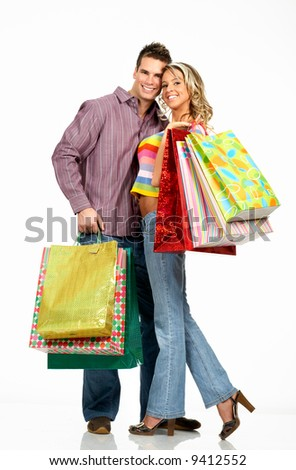 Shopping  couple  smiling. Isolated over white background - stock photo