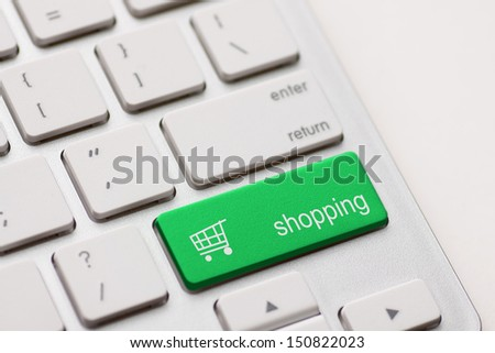 shopping enter button key on white keyboard - stock photo