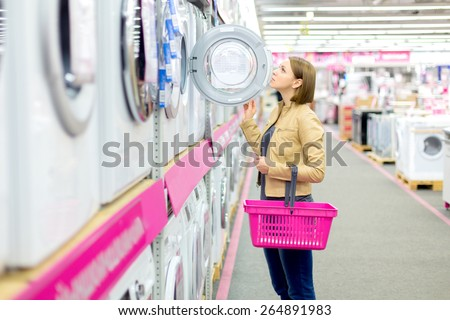 Shopping for a washer and dryer - stock photo