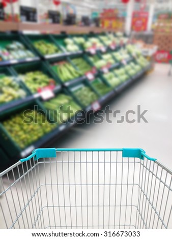 shopping for some fruits and vegetables in supermarket with shopping cart - stock photo