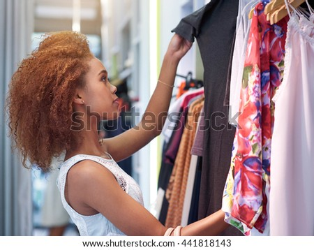 Shopping for the perfect outfit - stock photo