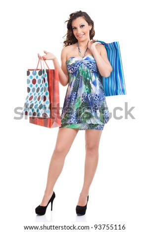 shopping girl in summer dress with shopping bags, isolated on white background - stock photo