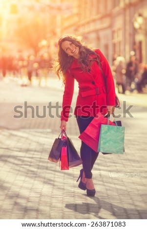 Shopping Girl / Vintage style photo with custom white balance, color filters, vignette effect, and some fine film noise added - stock photo