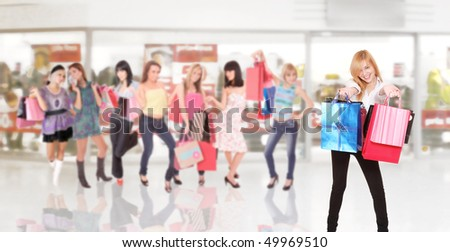 shopping  group of friends enjoying sales in a mall - stock photo