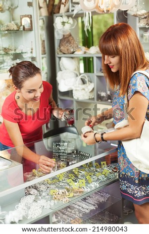 Shopping in a accessory boutique - stock photo