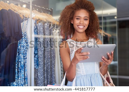 Shopping in store and online - stock photo