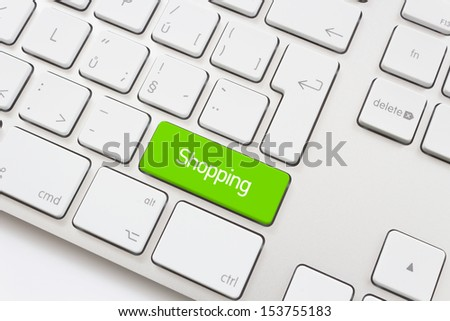 Shopping key on a white keyboard - stock photo