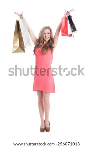 Shopping lady expressing joy and excitement on white background - stock photo