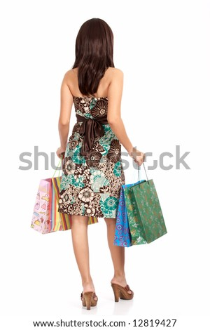 shopping lady holding shopping bags -  rear view - stock photo
