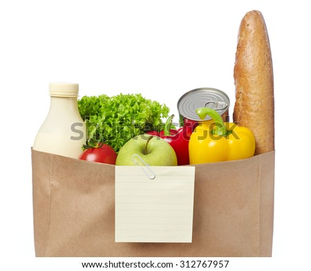 Shopping list on a bag of groceries - stock photo