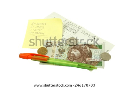 Shopping list with pen, receipt and Polish money (bill and coins) - stock photo