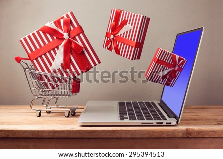 Shopping online concept with laptop computer and git box - stock photo