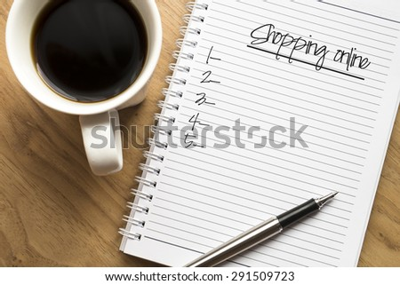 Shopping online written on book with black listing, planning conceptual - stock photo