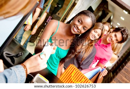 Shopping people at a store queuing to pay - stock photo