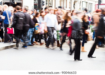 shopping people crossing the street in London City - stock photo