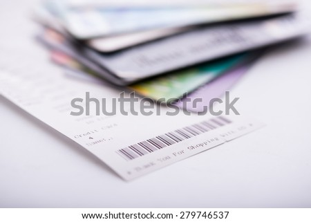 shopping receipt and credit or debit card - stock photo