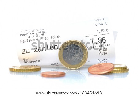 Shopping receipt with euro coins - stock photo