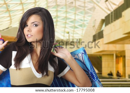 Shopping sexy girl smiling in the mall. - stock photo