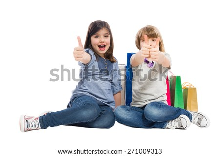 Shopping sisters or daughters showing thumbs up and acting excited - stock photo