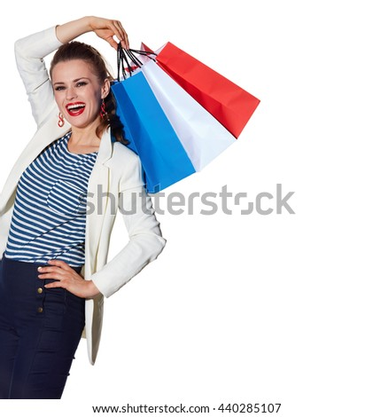 Shopping. The French way. Happy young woman with French flag colours shopping bags on white background - stock photo