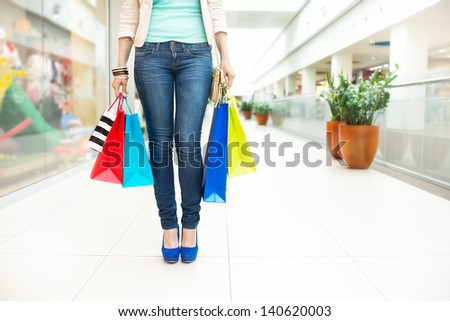 Shopping time, women legs in mall, shallow dof - stock photo