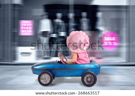 shopping tour, pink dressed Little girl driving big vintage old toy car and having fun - stock photo