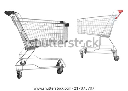 Shopping trolley stands in the midl of asphalt ground  - stock photo