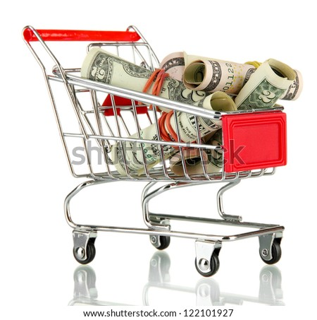 shopping trolley with dollars, isolated on white - stock photo