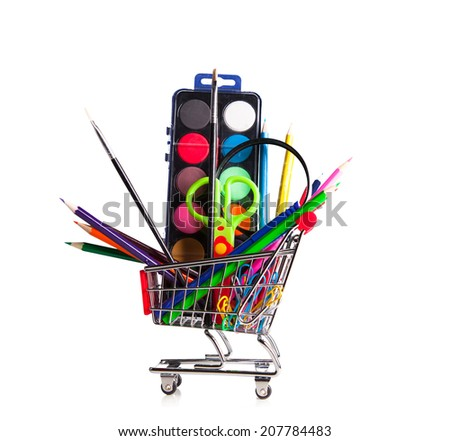 Shopping trolley with school stationery isolated, back to school concept - stock photo