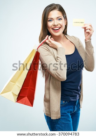 Shopping with credit card. Smiling woman standing with shopping bag. White background isolated. - stock photo