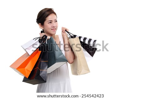 Shopping woman asian happy smiling holding shopping bags isolated on white background. Lovely fresh young Asian female model. - stock photo