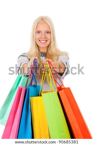 shopping woman happy excited smiling holding bags, looking at camera, wear winter knitted sweater, isolated over white background isolated on white background. - stock photo