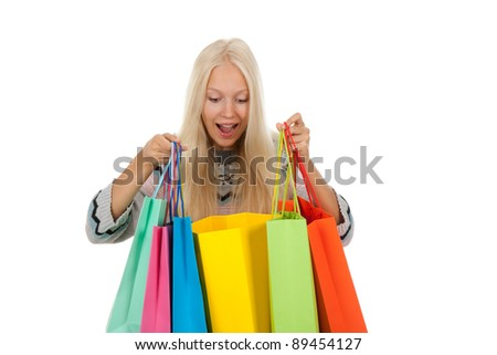 shopping woman happy excited smiling holding looking in bags, wear winter knitted sweater, isolated over white background isolated on white background. - stock photo