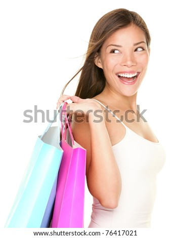 shopping woman happy looking at empty copy space. Isolated on white background. Beautiful Asian Caucasian female shopper. - stock photo