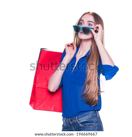 Shopping woman happy smiling holding shopping bags and exited about sales. Isolated on white background - stock photo