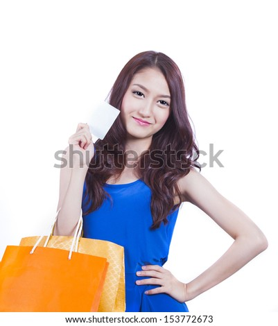 Shopping woman happy smiling holding shopping bags isolated on white background. with Asian Caucasian female model. - stock photo