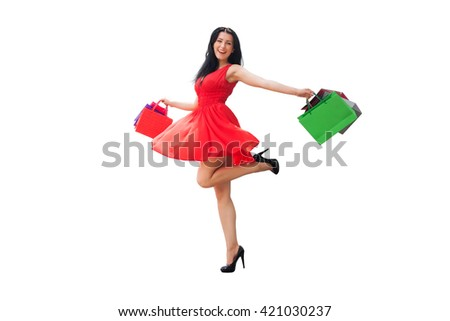 Shopping woman holding shopping bags in excitement. Beautiful young shopper smiling happy. - stock photo