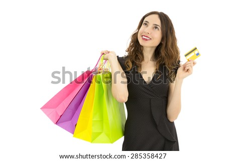 Shopping woman with a credit card looking to copy space - stock photo